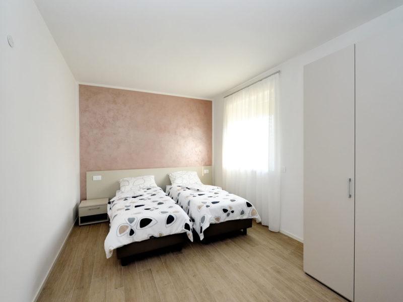 Appartamento-Olivo—Camera-da-letto—Agritur-Il-Melograno